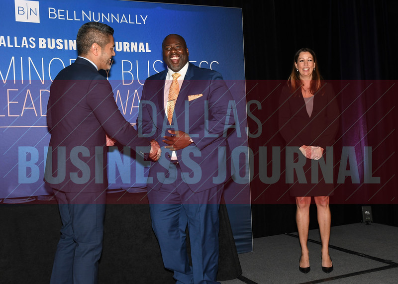 Thomas Crowther, Founder & CEO, The Crowther Group, (center) accepts his Minority Business Leader award from Chandhok, (left) and Mathes.