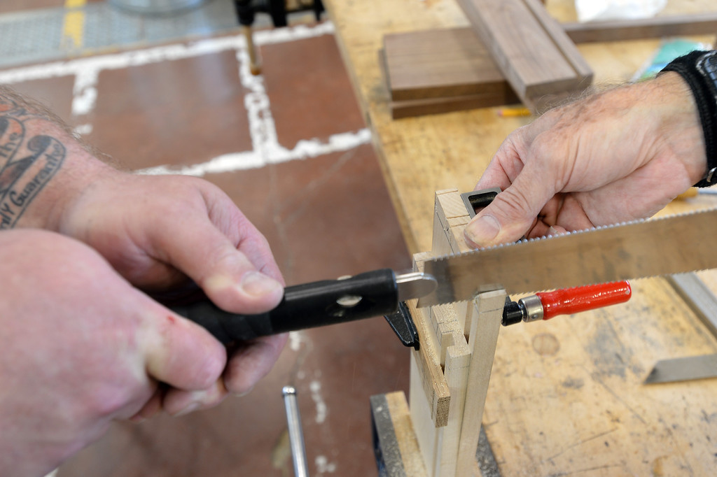 . Jason Deitch cuts dovetail joints as he works on a project in Pleasant Hill, Calif. on Wednesday, July 24, 2013. The Diablo Woodworkers are reaching out to military veterans like Deitch and emphasizing the therapeutic qualities of woodworking. (Kristopher Skinner/Bay Area News Group)