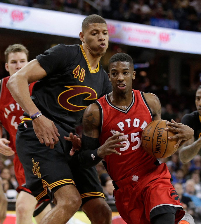 . Toronto Raptors\' Delon Wright, right, drives past Cleveland Cavaliers\' Edy Tavares in the second half of an NBA basketball game, Wednesday, April 12, 2017, in Cleveland. The Raptors won 98-83. (AP Photo/Tony Dejak)