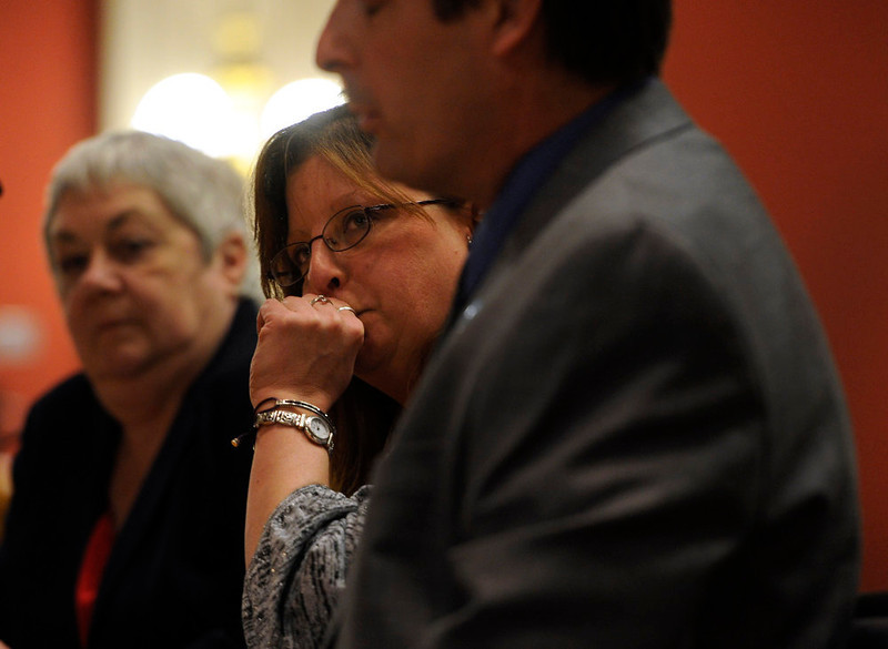 . Theresa Hoover, center, and her brother Dave Hoover, right, testify in favor of House Bill 1224. Theresa is the mother of A.J. Boik, a victim in the Aurora theater shooting. Testimony begins in front of the Senate Judiciary Committee at the state Capitol for Senate Bill 197 and House Bill 1224. (Photo By Kathryn Scott Osler/The Denver Post)
