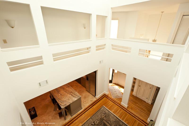 Stunning two-story, sunlight filled atrium, inlaid hardwood floors, open floor plan.