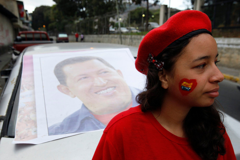 . A supporter of Venezuela\'s President Hugo Chavez stands outside a military hospital, where Chavez is staying at after his surprise return to Caracas February 18, 2013. Chavez made a surprise return from Cuba on Monday more than two months after surgery for cancer that has jeopardized his 14-year rule of the South American OPEC member. The 58-year-old socialist leader underwent a six-hour operation in Cuba on December 11. He had not been seen or heard in public since then until photos were published of him on Friday. REUTERS/Edwin Montilva