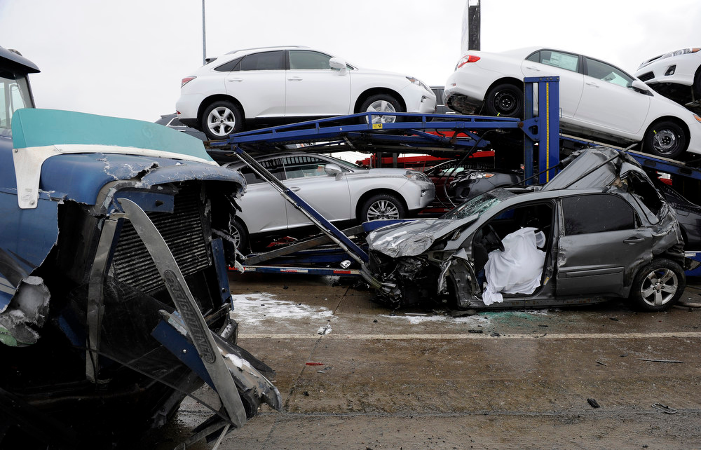 Description of . A section of multi-vehicle accident on Interstate 75 is shown in Detroit, Thursday, Jan. 31, 2013. Snow squalls and slippery roads led to a series of accidents that left at least three people dead and 20 injured on a mile-long stretch of southbound I-75. More than two dozen vehicles, including tractor-trailers, were involved in the pileups. (AP Photo/The Detroit News, David Coates)