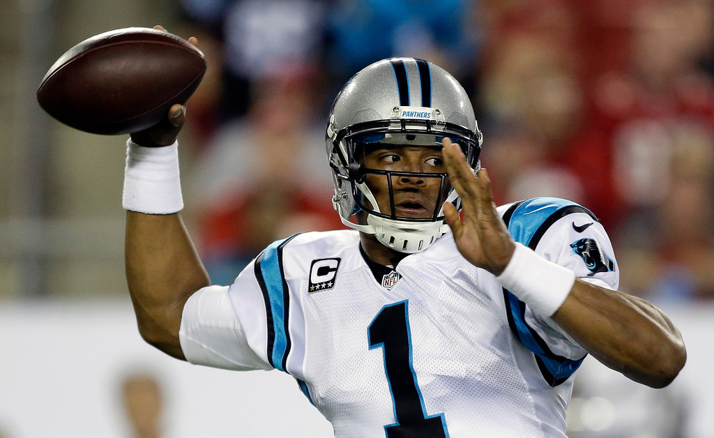 . Carolina Panthers quarterback Cam Newton throws a pass against the Tampa Bay Buccaneers during the first half of an NFL football game in Tampa, Fla., Thursday, Oct. 24, 2013. (AP Photo/John Raoux)
