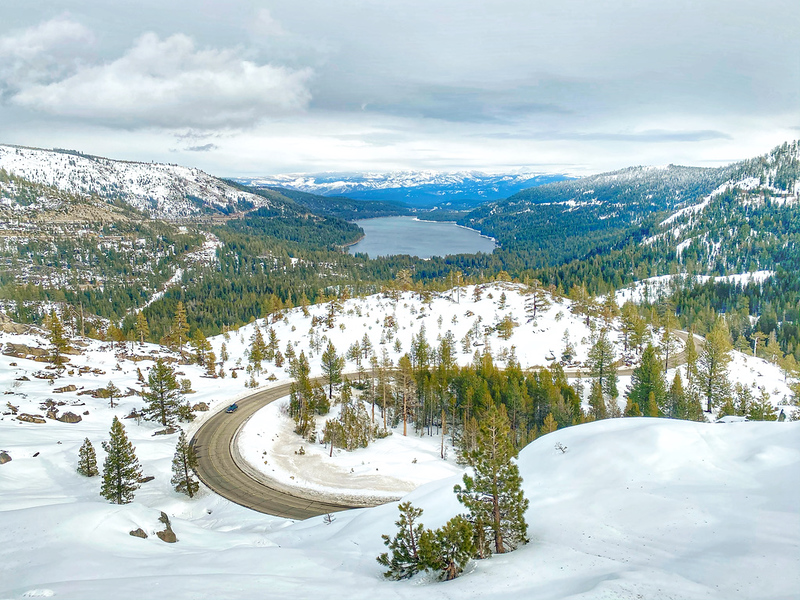 Donner Lake and snow capped mountains in Donner, Sierra Nevada Mountains.