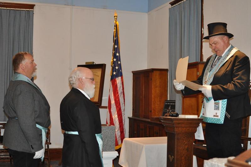 Worshipful Master Stan Weidner reading the Master Mason's Diploma to Bro. Pat Kellogg