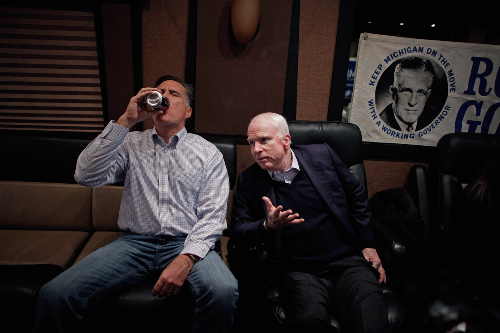 ". Republican presidential candidate and former Massachusetts Governor Mitt Romney (L) talks with former presidential nominee U.S. Sen. John McCain (R-AZ) on Romney\'s campaign bus in between events January 4, 2012 near Manchester, New Hampshire. McCain announced his endorsement of Romney the day after Romney beat former U.S. Senator Rick Santorum by only eight votes in Tuesday\'s ""first in the nation\"" Iowa Caucuses.  (Photo by Chip Somodevilla/Getty Images)"
