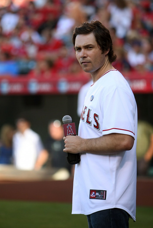 . Former American Idol finalist Michael Johns sings the national anthem before the game between the Los Angeles Angels of Anaheim aand the Baltimore Orioles on July 4, 2009 at Angel Stadium in Anaheim, California.  (Photo by Stephen Dunn/Getty Images)