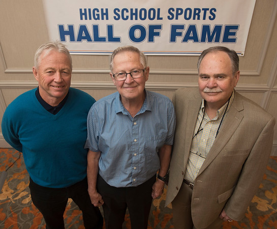 DAVID LIPNOWSKI / WINNIPEG FREE PRESS  (L-R) Brandon Vincent Massey volleyball team members of the 1968/69/70 teams: Dwight Kearns (1969), Coach Barry Diller (1968/69/70), and Gene Parks (1969) pose for a photo prior to the MHSAA awards honouring outstanding high school legends at the Holiday Inn South Saturday May 28, 2016.
