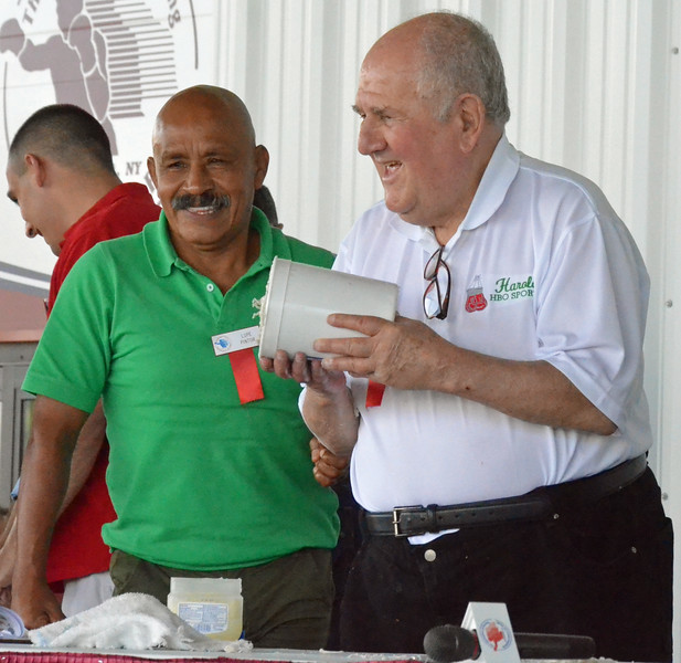 KYLE MENNIG - ONEIDA DAILY DISPATCH Harold Lederman, right, holds up the mold for his fist casting as Lupe Pintor looks on during the International Boxing Hall of Fame's Induction Weekend in Canastota on Friday, June 10, 2016.