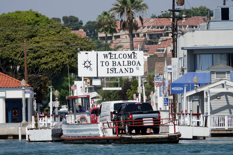 Passengers of the Balboa Ferry are welcomed to Balboa Island.