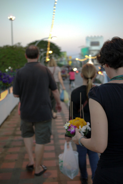 We walked to the river at dusk with our handmade krathongs during Loy Krathong in Chiang Mai, Thailand