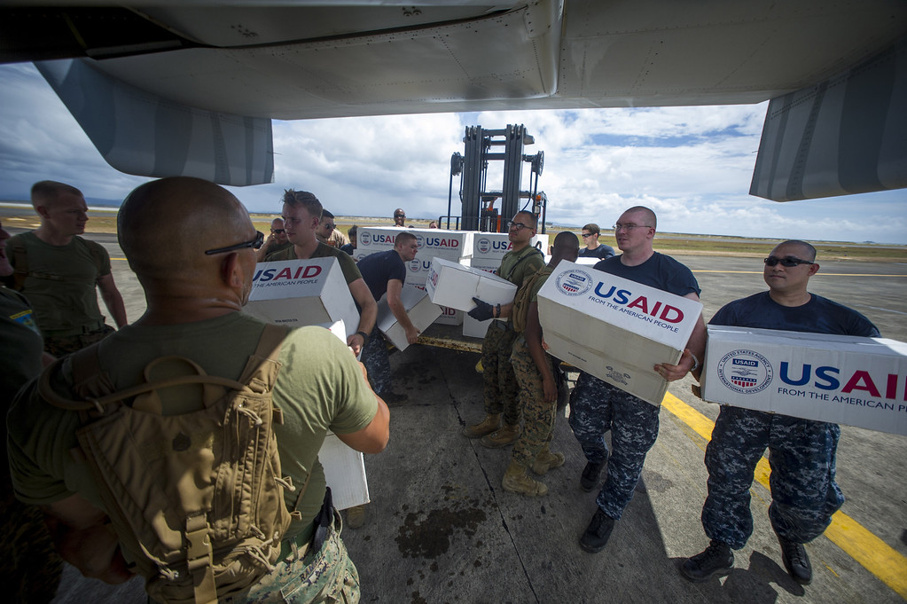 . In this handout image provided by the U.S. Navy, Sailors assigned to the aircraft carrier USS George Washington and Marines assigned to the 3d Marine Expeditionary Brigade load boxes of supplies into a U.S. Marine Corps Osprey from the Marine Medium Tiltrotor Squadron 262 to be airlifted to nearby villages in support of Operation Damayan November 20, 2013 in Tacloban, Philippines.  The George Washington Carrier Strike Group in coordination with Joint Task Force 505 personnel is assisting the Philippine government in ongoing efforts in response to super Typhoon Haiyan. (Photo by Trevor Welsh/U.S. Navy via Getty Images)