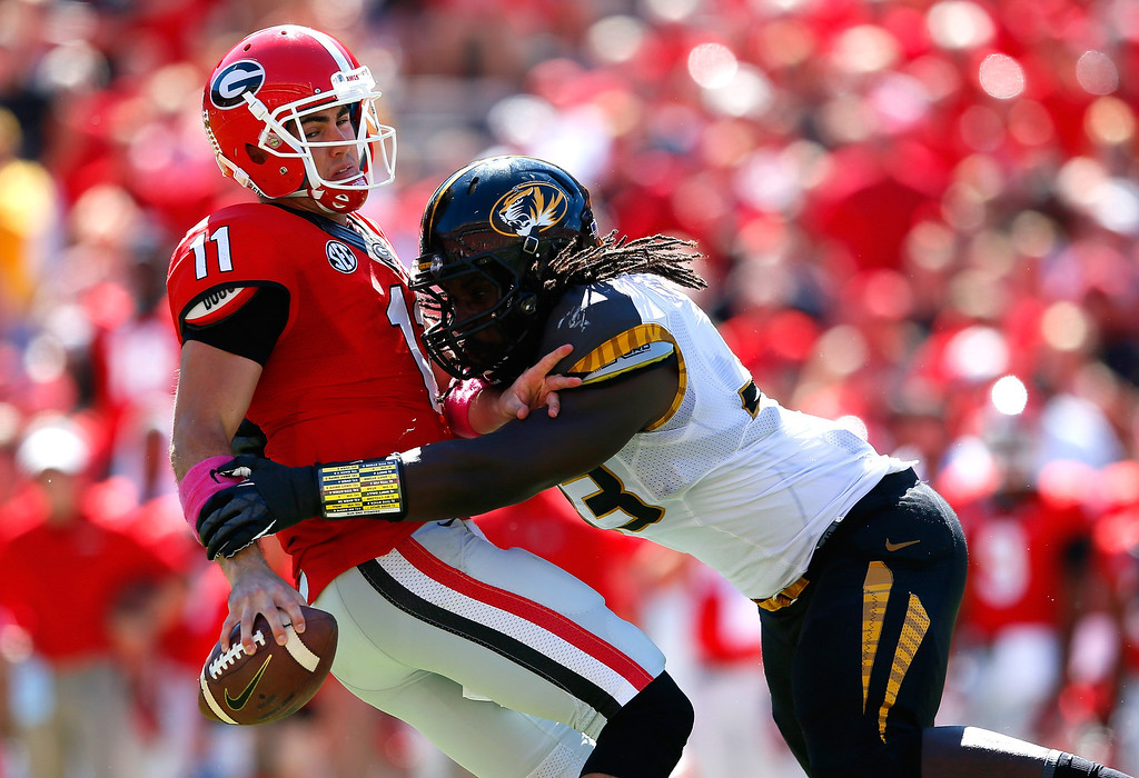 . Markus Golden #33 of the Missouri Tigers sackes Aaron Murray #11 of the Georgia Bulldogs at Sanford Stadium on October 12, 2013 in Athens, Georgia.  (Photo by Kevin C. Cox/Getty Images)