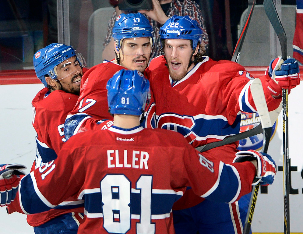 . Montreal Canadiens left wing Rene Bourque (17) celebrates with teammates after scoring against the New York Rangers during the second period of Game 5 of the NHL hockey Stanley Cup playoffs Eastern Conference finals, Tuesday, May 27, 2014, in Montreal. (AP Photo/The Canadian Press, Ryan Remiorz)