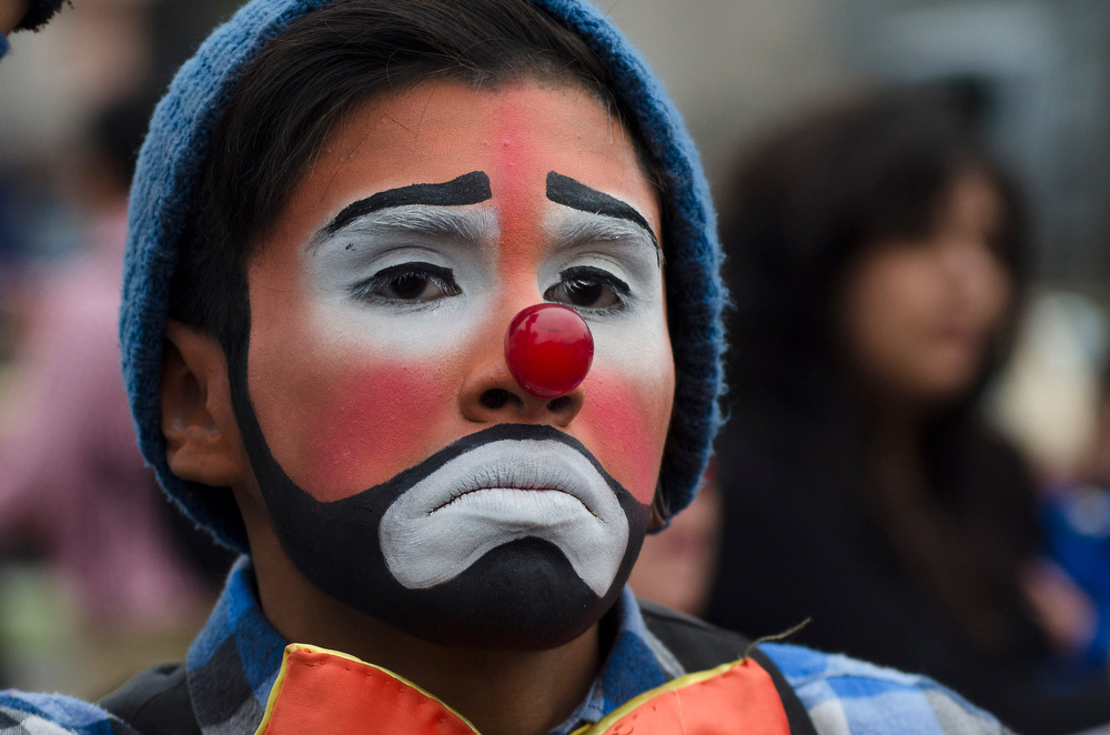 Description of . A circus clown participates in a protest against approved legislation that bans the use of animals in circuses, in Mexico City, Thursday, June 26, 2014. Circus performers in Mexico City fear that without their animals they will not survive because they believe people won't want to come to only see the clowns, the acrobats and trapeze artists. (AP Photo/Sean Havey)