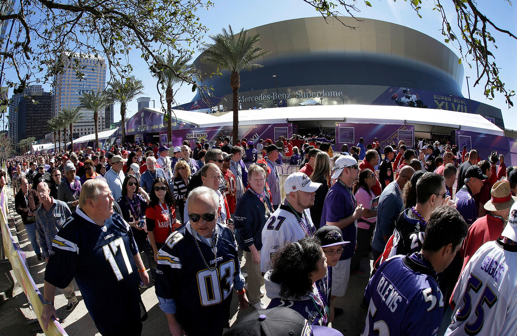 . In this photo made with a fisheye lens, fans line up to enter the Superdome before the NFL Super Bowl XLVII football game between the San Francisco 49ers and the Baltimore Ravens on Sunday, Feb. 3, 2013, in New Orleans. (AP Photo/Gene Puskar)