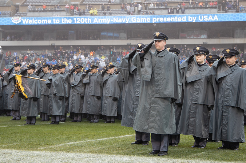 West Point cadets salute the audience during the march on.