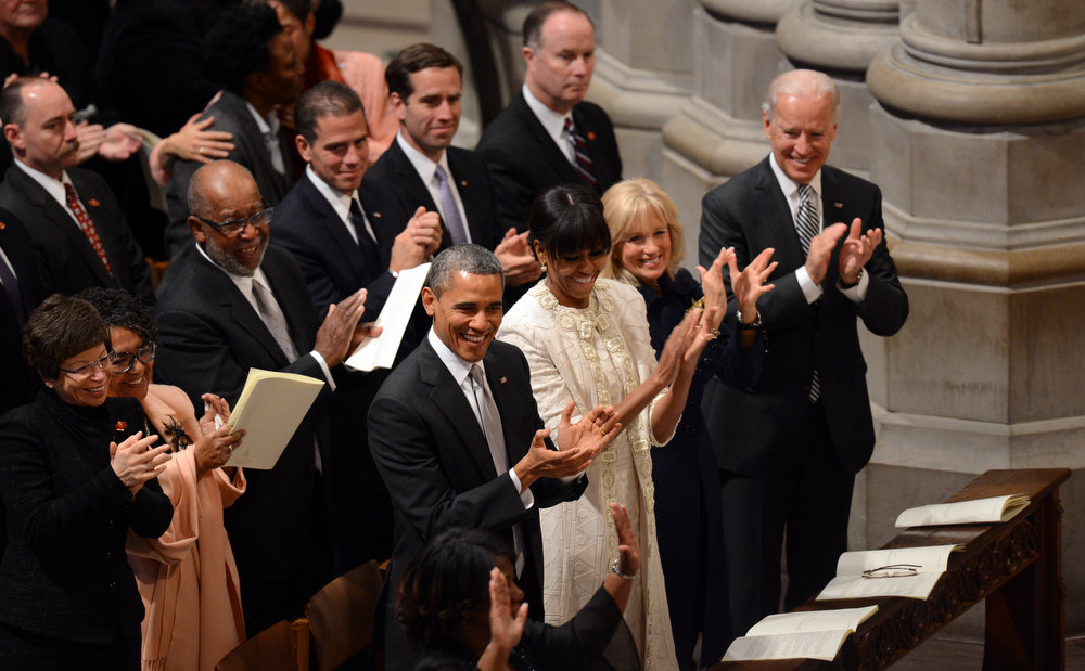 Description of . (Front L-R)US President Barack Obama, First Lady Michelle Obama, Dr. Jill Biden and  Vice President Biden applaud the choir as they attend a prayer service at Washington National Cathedral on January 22, 2013 in Washington, DC.   SAUL LOEB/AFP/Getty Images