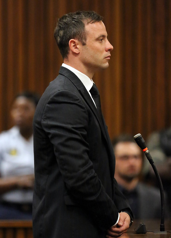 . Oscar Pistorius, stands for sentencing in court in Pretoria, South Africa, Tuesday, Oct. 21, 2014. (AP Photo/Themba Hadebe, Pool)