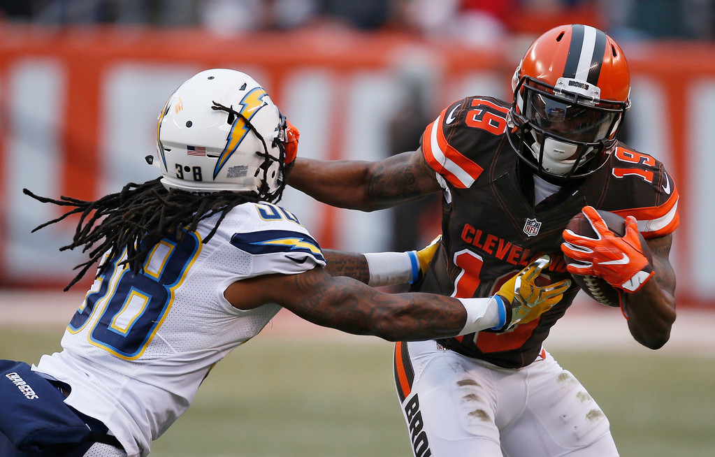 . Cleveland Browns wide receiver Corey Coleman (19) avoids a tackle after a pass reception in the first half of an NFL football game against the San Diego Chargers, Saturday, Dec. 24, 2016, in Cleveland. (AP Photo/Ron Schwane)