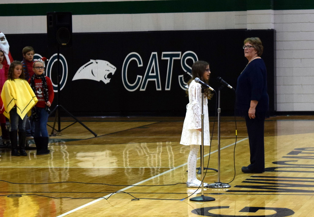 """. Emma Feather sings a solo during Fleming Elementary\'s performance of \""""Song of Peace,\"""" part of their production of \""""Once on a Housetop\"""" Monday, Dec. 11, 2017."""