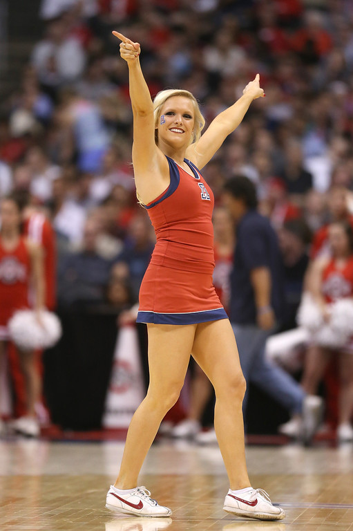 . An Arizona Wildcats cheerleader performs during a break in the game against the Ohio State Buckeyes during the West Regional of the 2013 NCAA Men\'s Basketball Tournament at Staples Center on March 28, 2013 in Los Angeles, California.  (Photo by Jeff Gross/Getty Images)