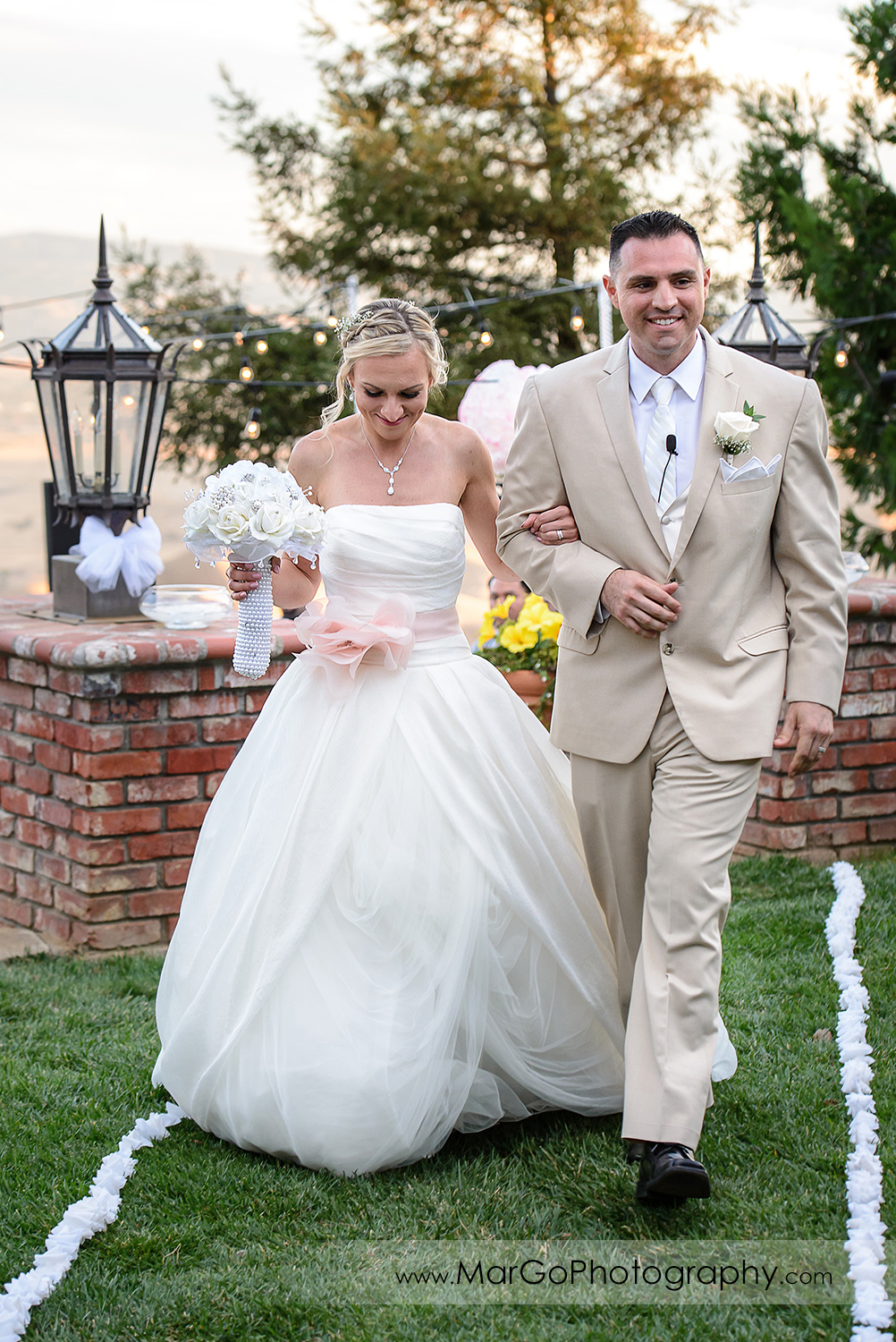 bride and groom walking down the aisle after backyard wedding ceremony