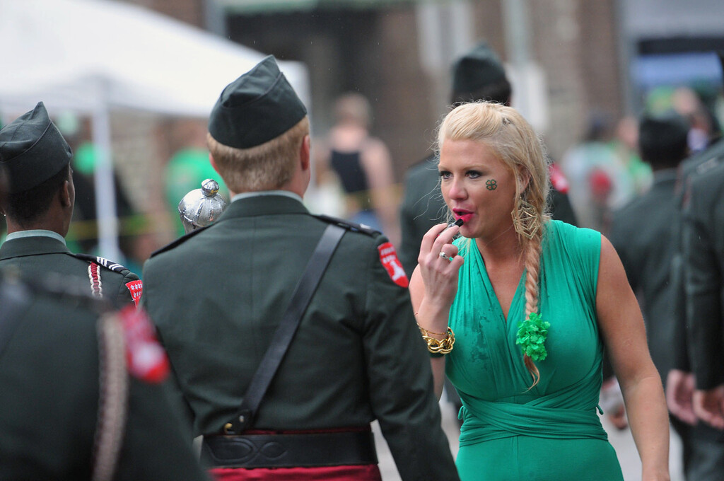 . Thea Simmons adds lipstick as she scouts a Benedictine Cadet kiss during Savannah\'s 190-year-old St. Patrickís Day parade, Monday, March 17, 2014, in Savannah, Ga. (AP Photo/The Morning News, Richard Burkhart)