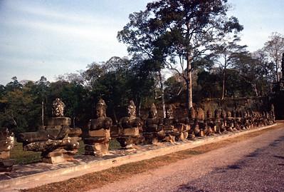Good Spirits holding Naga. South Gate Angkor Thom