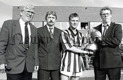 1996: 'Man of the Match' and captain Jimmy McConville receiving the Gerry Fegan Memorial Cup from Niall Fegan and Ger Fegan Jnr. RS9636103