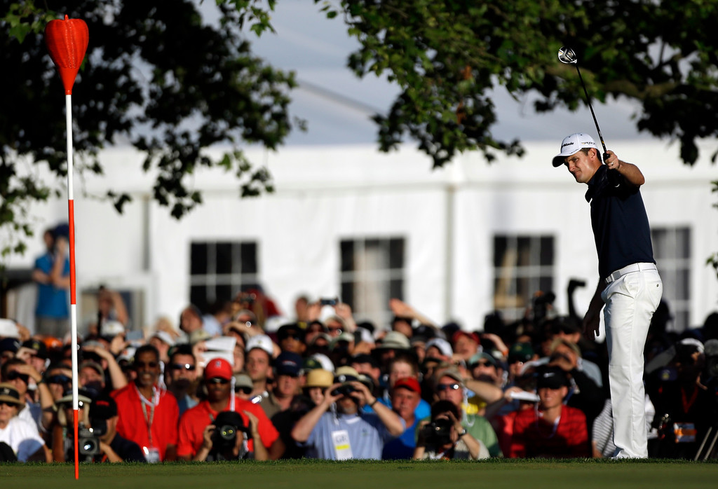 . Justin Rose, of England, reacts after a putt on the 18th hole during the fourth round of the U.S. Open golf tournament at Merion Golf Club, Sunday, June 16, 2013, in Ardmore, Pa. (AP Photo/Julio Cortez)