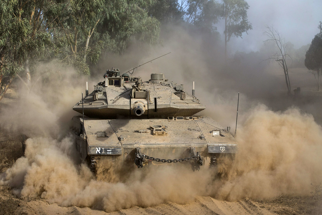 . An Israeli Merkava tank rolls near Israel\'s border with the Gaza Strip on July 17, 2014. Fighting between Israel and Hamas resumed in deadly earnest today, after a brief humanitarian ceasefire allowed Gaza residents to restock and hunker down, and as efforts towards a lasting truce intensified. AFP PHOTO / JACK GUEZ/AFP/Getty Images