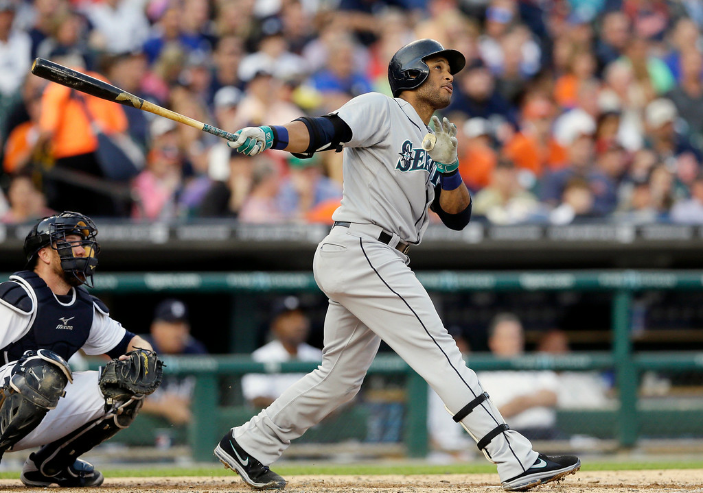 . Seattle Mariners\' Robinson Cano connects for a solo home run to right field off Detroit Tigers starting pitcher Rick Porcello during the third inning of a baseball game, Friday, Aug. 15, 2014, in Detroit. (AP Photo/Carlos Osorio)