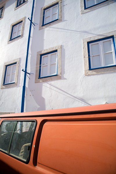 Old van and whitewashed facade, Alfama, Lisbon