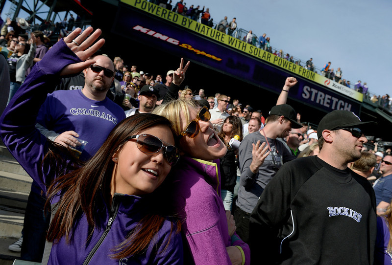 ". DENVER, CO. - APRIL 04: Natasha Duran, left, and Jordan Schmeltzer sing ""Take Me Out to the Ball Game\"" during seventh inning stretch of the Colorado Rockies home opener against the Arizona Diamondbacks at Coors Field in Denver, CO April 04, 2014. (Photo By Craig F. Walker / The Denver Post)"