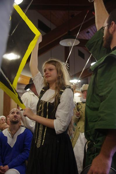 Grace helps display banner