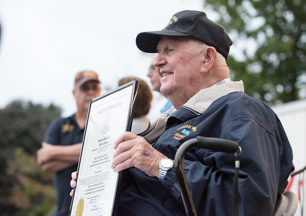 09/21/18 Wesley Bunnell | Staff 2018 Bristol Hometown Hero Ed Pelkey holds his proclamation from the State of CT which was presented by State Senator Henri Martin on Friday night at the Mum Festival on Memorial Boulevard.