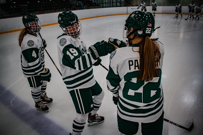 Holy Family Girls Varsity Hockey vs. Mound Westonka, 12/10/19: Grayson Limke '23 (19) and Olivia Paidosh '23 (22)