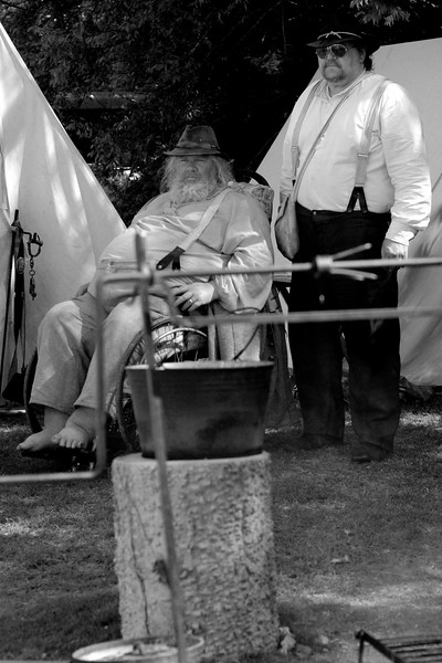 "Reenactors H.G. ""Garfleld"", a provost, and his assistant, Private Curtis ""Moose"" Sauls, spent 9 days at their position just outside the main camp, only taking a break for two hours each day, at Patriots Point, where a small group of Confederate reenactors set up camp, in Mt. Pleasant, South Carolina on Wednesday, April 13, 2011. ..The 150th Anniversary of the Firing on Ft. Sumter was commemorated with lectures, performances, demonstrations, and a living history throughout the area on James Island, Charleston, Mt. Pleasant, and Sullivan's Island during the week from April 8-14, 2011. Photo Copyright 2011 Jason Barnette"