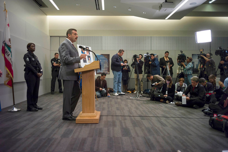 . LAPD police chief Charlie Beck updates the media about the ongoing investigation into the Dorner case.  At left is Sergeant Emada Tingirides who was one of the officers targeted by Dorner.  Photo by David Crane/Staff Photographer