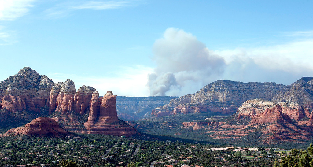. Smoke rises from the Slide Fire as it burns up Oak Creek Canyon on Thursday, May 22, 2014, in Sedona, Ariz.  The fire has burned approximately 4,800 acres. (AP Photo/Ross D. Franklin)