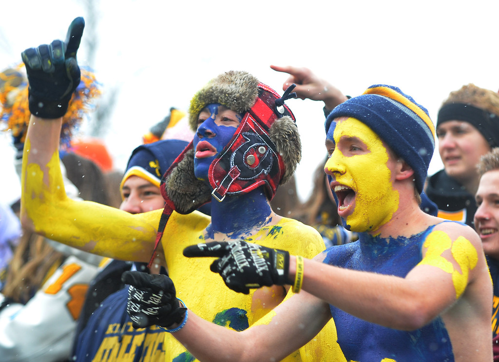 . Michael Allen Blair/ MBlair@News-Herald.com Kirtland fans celebrate a second quarter touchdow just before halftime during Friday\'s Div VI state championship victory over Wayne Trace at Fawcett Stadium in Canton.