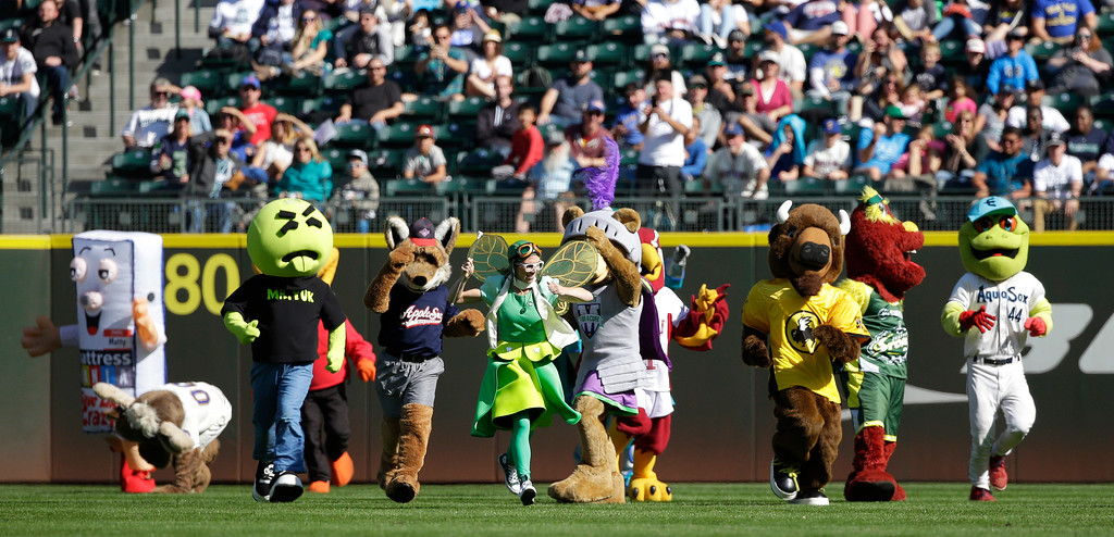 . A group of mascots runs on the field during an inning break at Safeco Field during a baseball game between the Seattle Mariners and the Cleveland Indians, Sunday, Sept. 24, 2017, in Seattle. (AP Photo/Ted S. Warren)