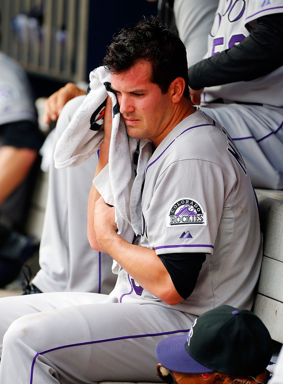 . Jeff Manship #50 of the Colorado Rockies sits in the dugout during a game against the New York Mets at Citi Field on August 8, 2013 in the Flushing neighborhood of the Queens borough of New York City. The Mets defeated the Rockies 2-1.  (Photo by Jim McIsaac/Getty Images)