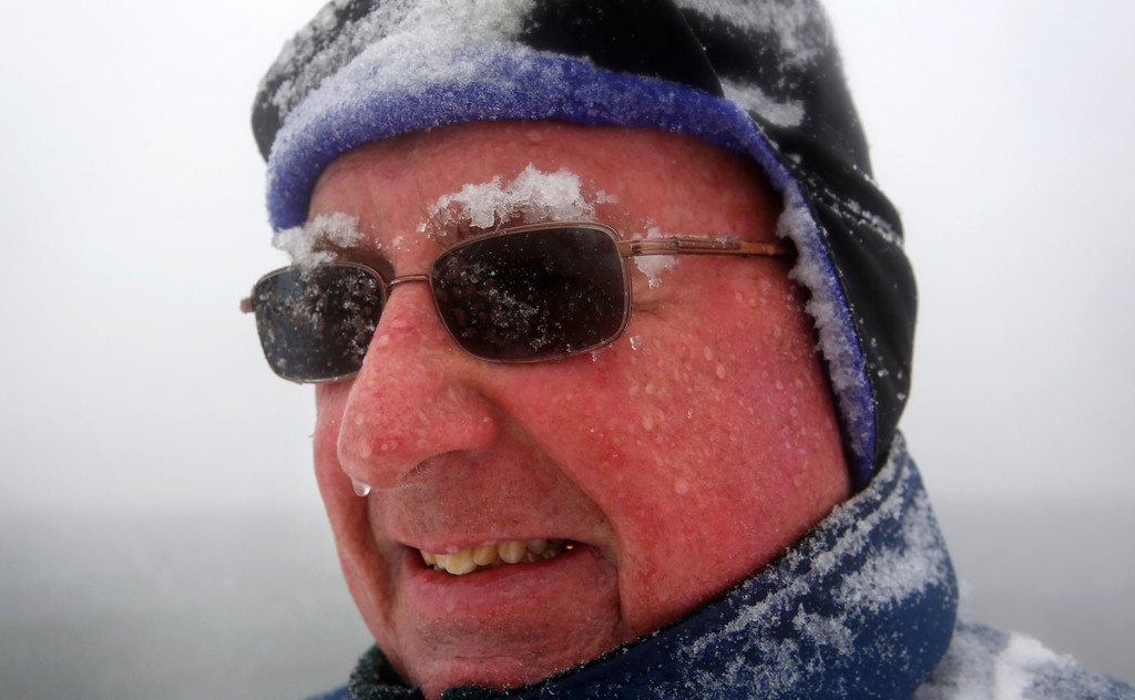 ". Snow accumulates on Paul Knight\'s eyebrows as he walks during a nor\'easter, Tuesday, March, 13, 2018, in Portland, Maine. ""It\'s typical March weather, we\'re not out of winter yet, that\'s for sure.\"" he said. \""The groundhog was right, six more weeks of winter and probably then some...\"" (AP Photo/Robert F. Bukaty)"