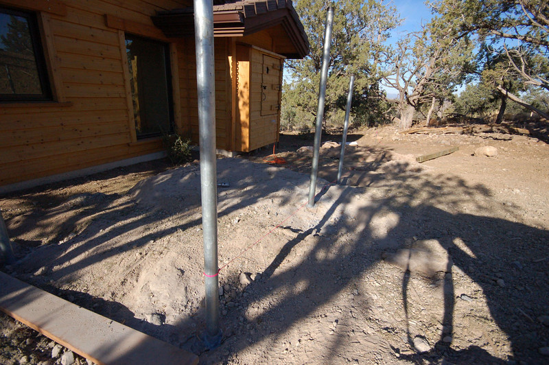 """2"""" galvanized pipe epoxied into holes core drilled 6"""" deep in blue granite: 4""""x6"""" treated fence posts will be bracketed to these pipes."""