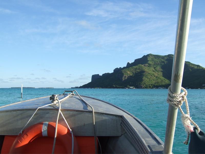Boat ride across lagoon to Kuriri Village.