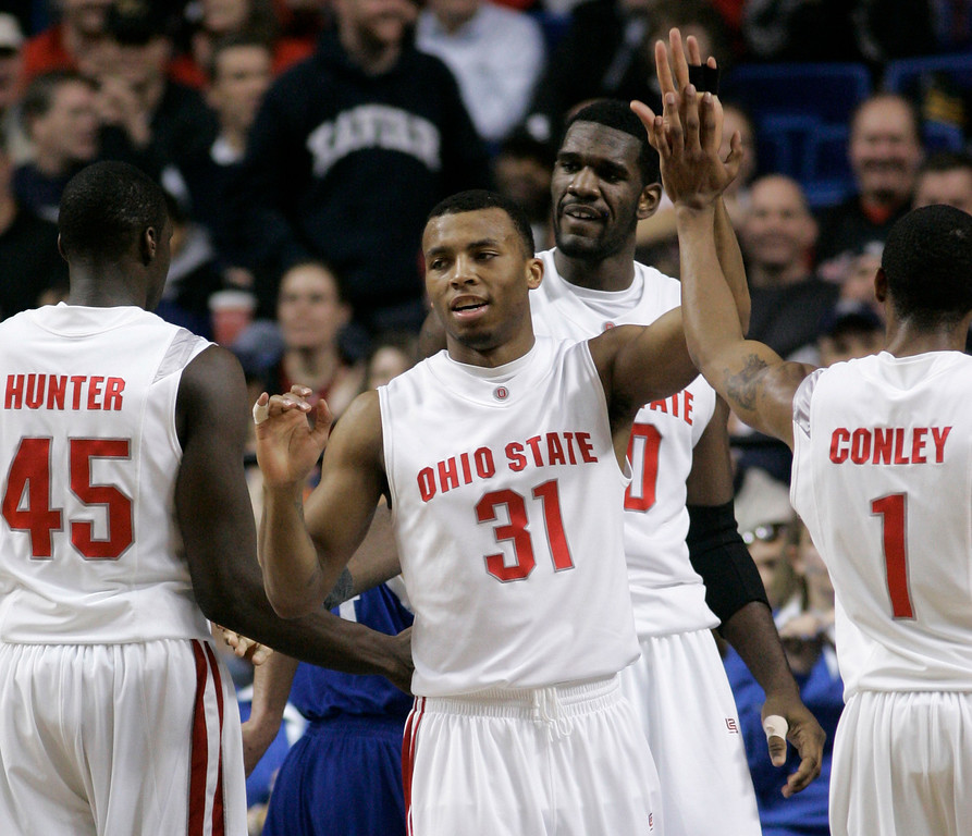 . In this March 15, 2007 file photo, Ohio State guard Daequan Cook (31) celebrates with teammates Othello Hunter (45), Mike Conley Jr. (1) and Greg Oden as they play against Central Connecticut during the first half of a first-round basketball game in the South Regional of the NCAA Tournament in Lexington, Ky. Freshman teammates Mike Conley Jr. and Daequan Cook said Friday, April 20, 2007 they will make themselves available for the draft. (AP Photo/Al Behrman, FILE)
