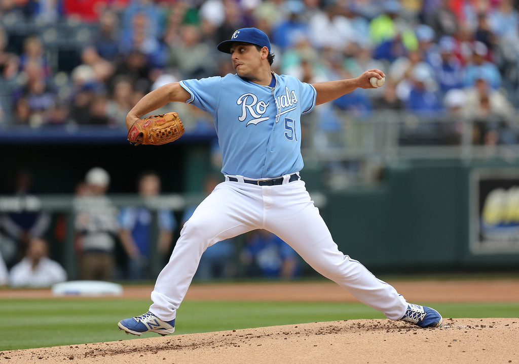 . KANSAS CITY, MO - MAY 14:  Jason Vargas #51 of the Kansas City Royals throws in the first inning against the Colorado Rockies  at Kauffman Stadium on May 14, 2014 in Kansas City, Missouri. (Photo by Ed Zurga/Getty Images)